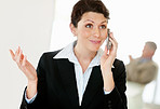 Middle aged business woman talking on cellphone