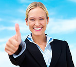 Happy blond business woman showing thumbs up