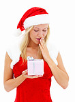Beautiful woman dressed as Santa and holding a gift isolated on white