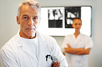 Male radiologist with nurse in background