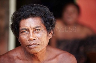Buy stock photo Portrait of a middle-aged Thai man staring at the camera