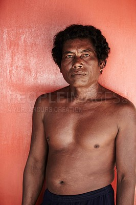 Buy stock photo A shirtless Thai man gazes pensively into the distance