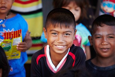 Buy stock photo Portrait of young rural boy from Thailand smiling with other kids