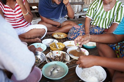 Buy stock photo A rural family from Thailand eating their meal