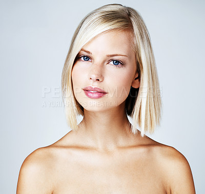 Buy stock photo Portrait of a cute young woman with striking blue eyes