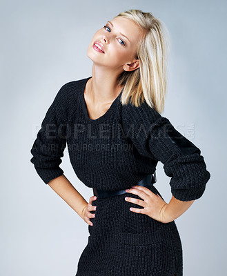 Buy stock photo Pretty blonde girl posing while isolated against a grey background
