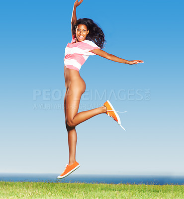 Buy stock photo Woman leaping for joy outdoors with sneakers and T-shirt on, bottom half exposed
