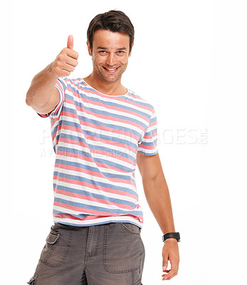 Buy stock photo Young man smiling and giving the thumbs-up gesture while isolated on white