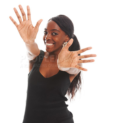 Buy stock photo Happy young woman laughing while stretching out her hands