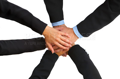 Buy stock photo High angle shot of three business colleagues with their hands in a huddle
