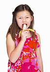 Portrait of a sweet young girl eating banana isolated on white