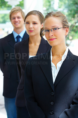 Buy stock photo Portrait of three businesspeople standing in a line outside
