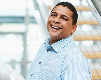 Buy stock photo Portrait of a mixed race successful business man laughing at office