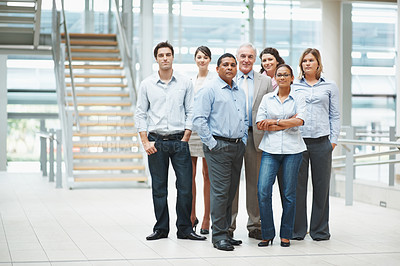 Buy stock photo Portrait of confident business people standing together in a group at office