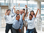 Business success - Happy multi ethnic team with hands raised