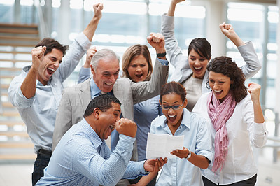 Buy stock photo Group of business colleagues celebrating over finalization of a contract