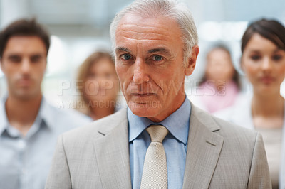 Buy stock photo Leadership - Confident senior business man with his colleagues at back