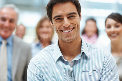 Buy stock photo Smart successful business executive with his colleagues in the background