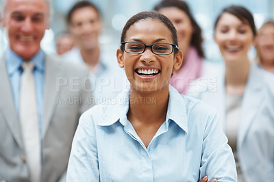Buy stock photo African American business woman smiling with executives in the background