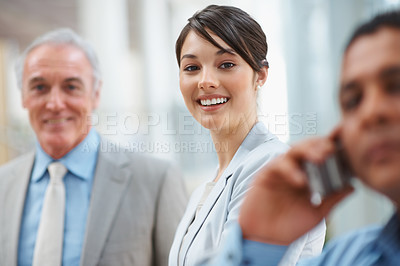 Buy stock photo Portrait of a confident smiling business woman with her colleagues at work
