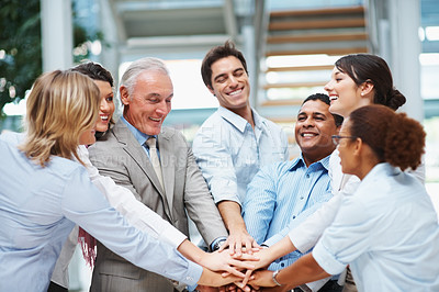 Buy stock photo A diverse group of business workers with their hands together in form of teamwork