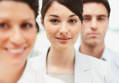 Buy stock photo Portrait of a cute young business woman standing in line with colleagues