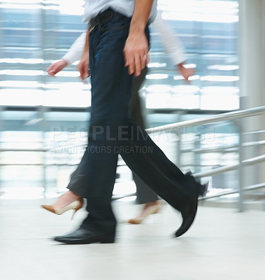 Buy stock photo Low section of business people walking fast while at the workplace