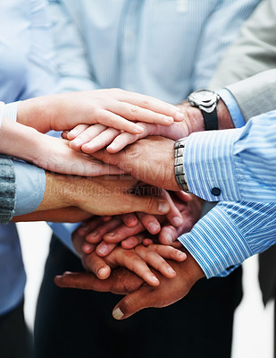 Buy stock photo Closeup of a diverse group of business colleagues with their hands on top of one another in a symbol of unity