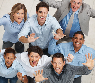 Buy stock photo Team success - Top view of a group of business people raising hands in joy
