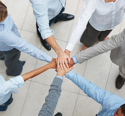 Buy stock photo Business teamwork - Top view of executives with their hands together in a circle