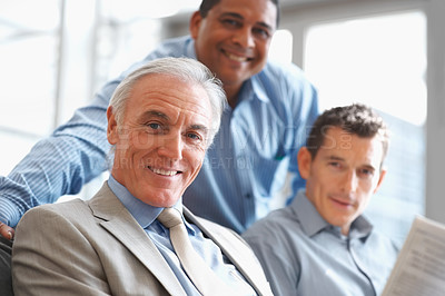 Buy stock photo Portrait of confident and successful team of business men smiling