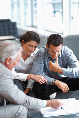 Buy stock photo Financial planner explaining to a mature couple and investment scheme