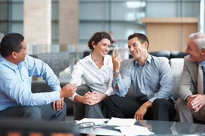 Buy stock photo Group of successful multi ethnic business team having a casual talk