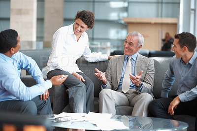 Buy stock photo Portrait of successful business people having a casual talk in the office
