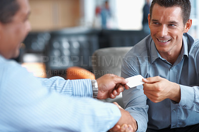 Buy stock photo Two successful business people shaking hands at office