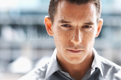 Buy stock photo Closeup portrait of a handsome young business man on blur background