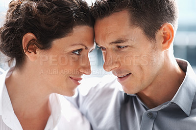 Buy stock photo Closeup portrait of a middle aged couple looking at each other