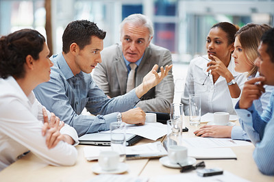 Buy stock photo Business meeting - Young man presenting his ideas to colleagues