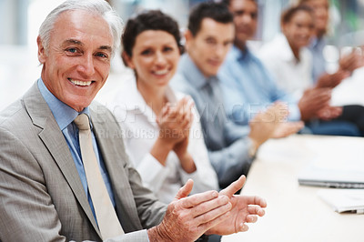 Buy stock photo Successful business executives applauding and smiling at you in a board room - copyspace