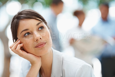 Buy stock photo Day dreaming - Pretty Caucasian business woman with hand on chin