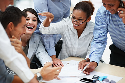 Buy stock photo Happy and successful team of colleagues sitting together to work out business plans