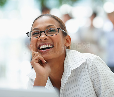 Buy stock photo Cute African American business woman laughing over a thought