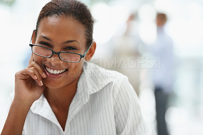 Buy stock photo Pretty African American business woman wearing spectacles and smiling at the office
