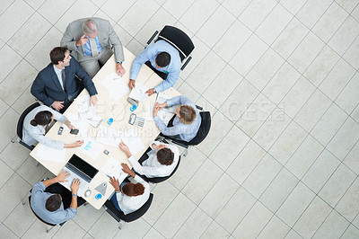 Buy stock photo Top view of successful business people sitting at a table for meeting with copyspace