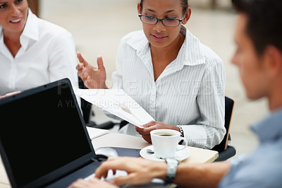 Buy stock photo African American business woman at a meeting along with other colleagues