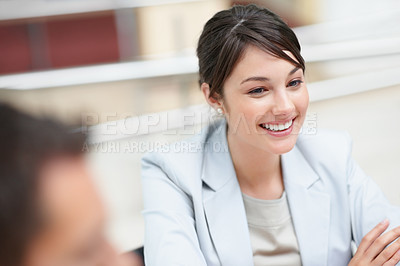 Buy stock photo Portrait of a pretty young business woman smiling at a meeting