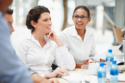 Buy stock photo Successful business women seated for a boardroom meeting