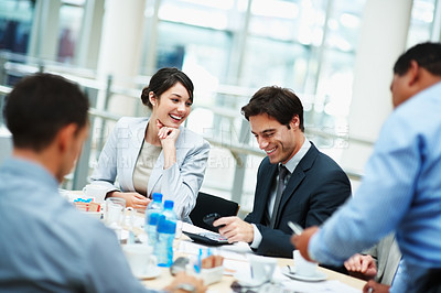Buy stock photo Successful and happy business people sitting for a meeting