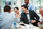 Happy man joining hands in unity with a colleague at meeting