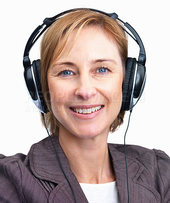 Buy stock photo Portrait of mature woman on headphones listening to music isolated over white background